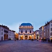 Photo taken at Palazzo della Loggia by Turismo B. on 7/23/2013