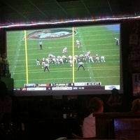 Photo taken at Charlie's Neighborhood Bar & Grill by Jessica L. on 11/29/2014