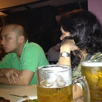 Photo taken at Quattro Bar & Grill by Joel M. on 10/23/2012