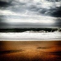 Photo taken at Praia Brava by Valerio V. on 7/20/2013