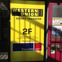 Photo taken at Western Union by Erich M. on 3/26/2013
