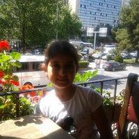 Photo taken at Cafe Emirgan by Gamze D. on 6/10/2014