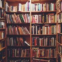 Photo taken at Raven Used Books by Maddie S. on 4/19/2014