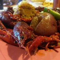 Photo taken at Red Crawfish Seafood & Wings by Michael C. on 4/30/2015