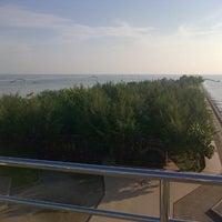 Photo taken at Pantai Boom Tuban by Evelyn S. on 7/24/2013