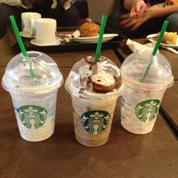 Photo taken at Starbucks by Giovanna A. on 7/24/2013