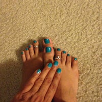 Photo taken at World Nails by Betty R. on 9/6/2013