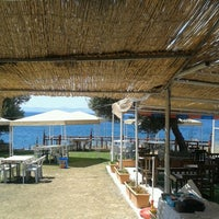 Photo taken at Cey Cey Beach Club by Hülya Ç. on 7/25/2013