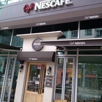 Photo taken at Café NESCAFÉ by Kyutae T. on 6/14/2013