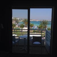 Photo taken at Okeanos Beach Hotel by Sergey K. on 6/15/2015