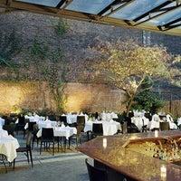 Photo taken at Revel Restaurant and Garden by Revel Restaurant and Garden on 7/25/2013
