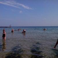 Photo taken at Пляж «Песочный» / Pesochniy Beach by Kolyan D. on 8/10/2013