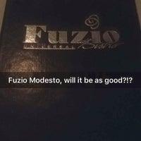 Photo taken at Fuzio Universal Bistro by Marie B. on 12/27/2015