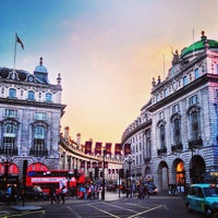 Photo taken at Piccadilly Circus by Justine  E. on 7/11/2013