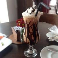 Photo taken at Santidade Café by Josilaine M. on 1/12/2014