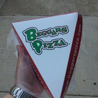 Photo taken at Beggars Pizza by Alex B. on 5/19/2013