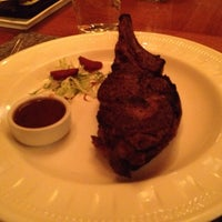 Photo taken at Westbank Grill at Four Seasons Resort Jackson Hole by Kris C. on 7/27/2014