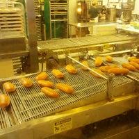 Photo taken at Krispy Kreme Doughnuts by Whitney H. on 1/27/2013