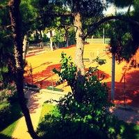 Photo taken at A.O.K. Tennis Club by Alexis P. on 6/8/2014