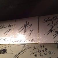 Photo taken at 炭焼き焼酎 宝 新橋烏森口店 by Masaki M. on 1/25/2014