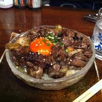 Photo taken at 炭焼き焼酎 宝 新橋烏森口店 by Masaki M. on 1/17/2013