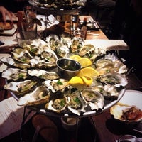 Photo taken at Hog Island Oyster Co. by Selena M. on 1/10/2014