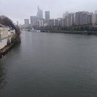 Photo taken at Pont de Courbevoie by Tuğrul Ç. on 11/24/2015