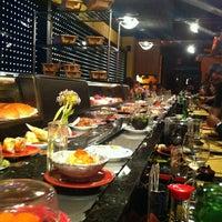 Photo taken at Zen Sushi by Cristina Z. on 5/15/2013