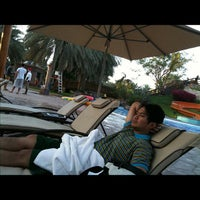 Photo taken at Emirates Palace Hotel Swimming Pool by Joseph O. on 12/25/2012