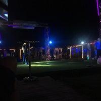 Photo taken at Planet Beach Club by Beyza Ö. on 9/25/2017