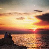 Photo taken at Rovinj Harbor by Cesar P. on 7/6/2013