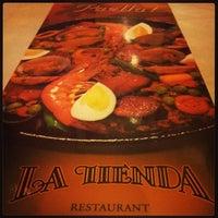 Photo taken at La Tienda by Lizza L. on 9/1/2013