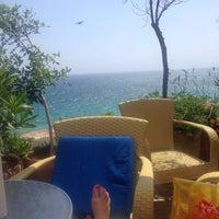 Photo taken at Atlantica Aeneas Resort Hotel pool by Irena S. on 6/25/2015