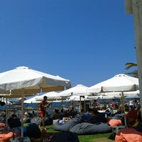 Photo taken at Mango Beach Bar by Aggelos H. on 8/9/2014