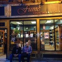 Photo taken at Fume Cigar Shop & Lounge by Dennis on 5/16/2014
