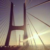 Photo taken at Ponte Vasco da Gama by Marina B. on 7/20/2013