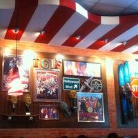Photo taken at TGI Fridays by Juan E. on 10/31/2012