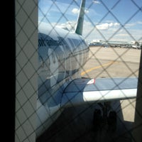 Photo taken at Gate A27 by Tim P. on 8/5/2013