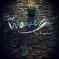 Photo taken at The Wave Restaurant by Bunnie C. on 12/17/2012