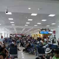 Photo taken at Cancún International Airport (CUN) by Oscar R. on 8/25/2013