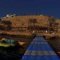 Photo taken at Beach at Reef Oasis Blue Bay Resort by Gulnaz G. on 2/6/2014