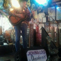 Photo taken at Robert's Western World by Kathryn C. on 12/31/2012