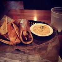 Photo taken at Taziki's Cafe of Charleston by Jonathon T. on 10/14/2013