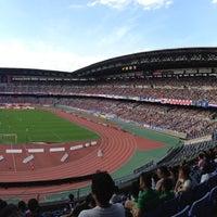 Photo taken at Nissan Stadium by Hirokazu T. on 10/6/2012