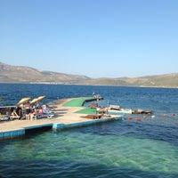 Photo taken at Havuzlu Plaj by Elif S. on 8/8/2013
