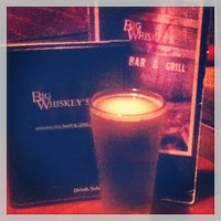 Photo taken at Big Whiskey's American Bar & Grill by Amanda C. on 3/30/2013