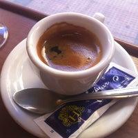 Photo taken at Cafetería Pastelería El Buñuelo by Oscar L. on 2/23/2013