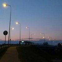Photo taken at Buļļupes tilts by Edgars L. on 4/16/2016