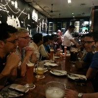 Photo taken at Brotzeit German Bier Bar & Restaurant by Masa Y. on 8/26/2013