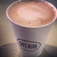 Photo taken at Cafe Neon by Jessica M. on 1/6/2014